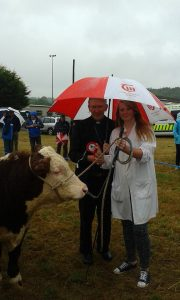 Grace Bateman pictured with her bull Slieveroe Nick ET receiving 1st prize in the Young Handers Class from Bishop John Buckley (Bishop of Cork & Ross)