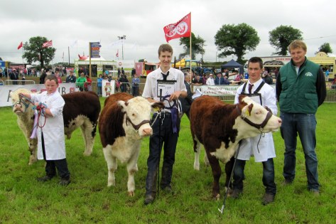 Society President Ivor Deverell pictured with Young Handler winners  R to L, James M Good, Niall Roycroft & Liam Farrell.