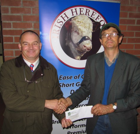 Denis GVM Kilmallock presents a cheque for sponsorship for the National Hereford Calf Show to Show Secretary Joe Deverell