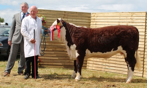 Champion Kye Sheila 679 with Owner Padraig McGrath and Judge John McMordie NI.