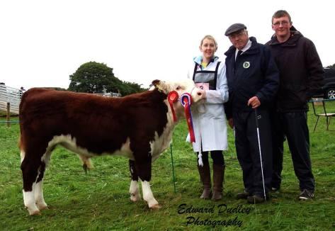 Overall Junior Champion 'Tullaha Florence' with Maura Neenan Creagan (handler), Martin Murphy (judge) and Shane Murphy O' Brien (junior judge)