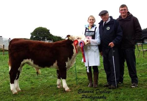 Overall Junior Champion 'Tullaha Florence' with Maura Neenan Creagan (handler), Martin Murphy (judge) and Shane Murphy O' Brien (junior judge)