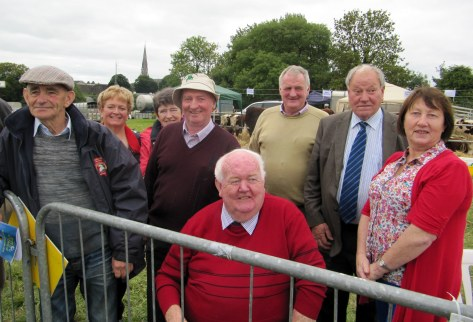 Some members of the munster tour group with Philip Smyth host breeder and Society President John Neenan as they watch the judging with keen interes