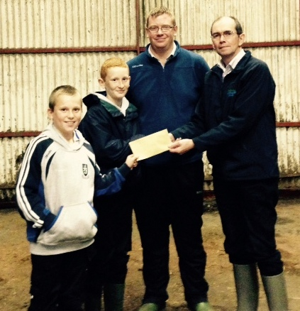 Conor and Padraig Jones receives prize for the Res Champ male calf Clonroe Denis, Mervyn Parr Chairman, Patsy Wilson, Chancelor Mills, Sponsor