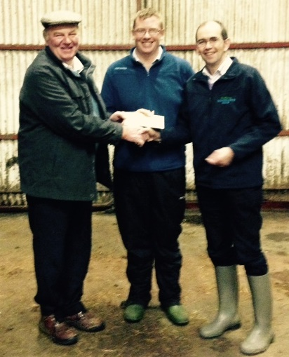Henry Parr receives a prize for the Res Champ female calf Tourtane Queen Lorraine, Mervyn Parr, Chairman and Patsy Wilson, Chancellors Mills, Sponsor