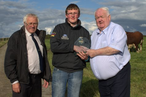 Martin Murphy Chairman Munster Branch IHBS with Shane O'Brien winner of weight guessing competition receives his trophy from Society President John Neenan