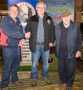John Foley, Ballyhea, Co. Cork, owner of the champion bullocks in the Irish Hereford Society Store Cattle Show and Sale recently in Golden Vale Mart, Kilmallock, Co. Limerick is congratulated by Liam Philpott, Irish Hereford Society and his father Tom Foley. The bullocks weighed in at 565K and sold for One thousand two hundred and seventy euro photo Ita West