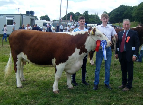 Reserve Hereford Champion Droumdaniel Mel Ella and Ronan McCarthy with Judge David Larkin