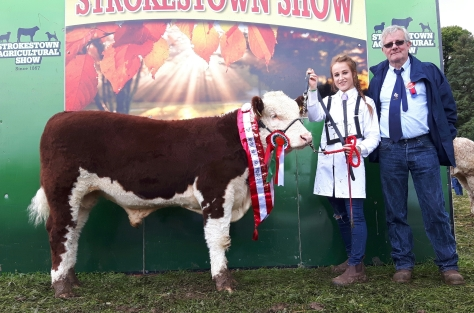 Champion Shiloh Farm Dynamite with Elanor Reilly and judge Society President Liam Philpott