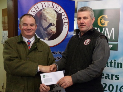 Denis Kirby GVM Kilmallock present a sponsorship cheque for the National Hereford Calf Show to Show Chairman Joe O'Connor