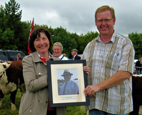 10A Mary Collins is presented with a photograph of her late husband Denis Chief Hereford Cattle Stewart for many years at Trim show by Francis Cotter show Chairman